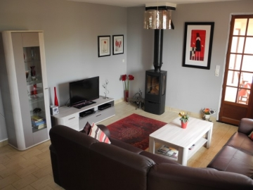 Fully refurbished living space opening onto terrace